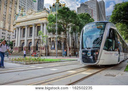 RIO DE JANEIRO, BRAZIL - NOVEMBER 16, 2016: The Municipal Theatre and Rio de Janeiro Light Rail at Cinelandia district of the city center