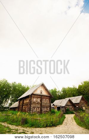 Slavic yard near the forest with a two-storey log hut Slavic type
