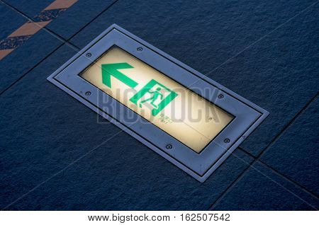 Fire exit signs at floor, emergency exit floor.
