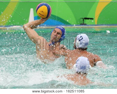 RIO DE JANEIRO, BRAZIL - AUGUST 10, 2016: Water Polo Team Hungary (in blue)  and Team Greece in action during Rio 2016 Olympics Men's Preliminary Round Group A match at the Maria Lenk Aquatic Center