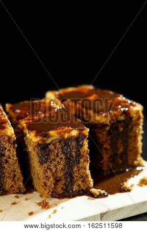 Cake toffee with chocolate on top and background