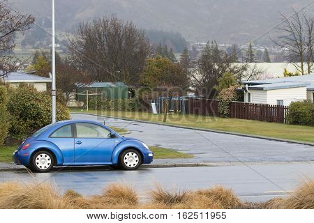 WANAKA TOWN NEW ZEALAND - SEPTEMBER 5 : blue volk swaken car parking in wanaka town important traveling destination in south island on september 5 2015 in wanaka town new zealand