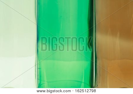 Empty glass bottles of mixed colors including green clear white brown