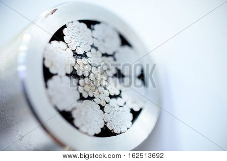 Cross-section of a steel rope. Abstract industrial background. Shallow depth of field.