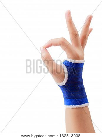 Close up of right female hand with blue wrist support gesturing sign ok (okay) isolated on white background clipping path.