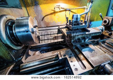 Vintage metal cutting lathe. The old mechanical cutting equipment.