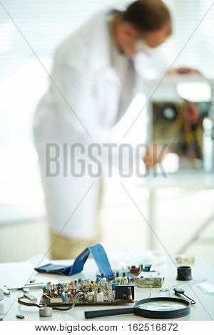 photo of chip and electronic details in laboratory