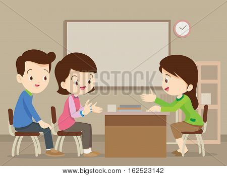Parent meeting with young teacher in classroom.