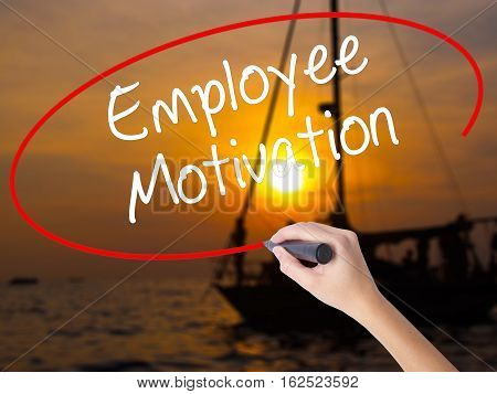 Woman Hand Writing Employee Motivation With A Marker Over Transparent Board.