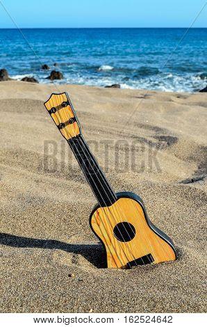 Guitar On The Sand Beach