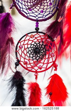 Red black and purple Dreamcatcher with bat made of feathers leather beads and ropes, hanging