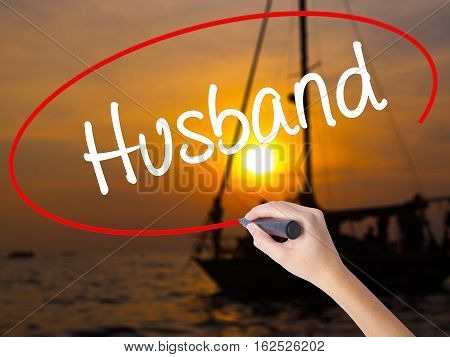 Woman Hand Writing Husband With A Marker Over Transparent Board.