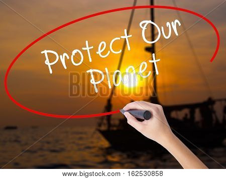 Woman Hand Writing Protect Our Planet With A Marker Over Transparent Board