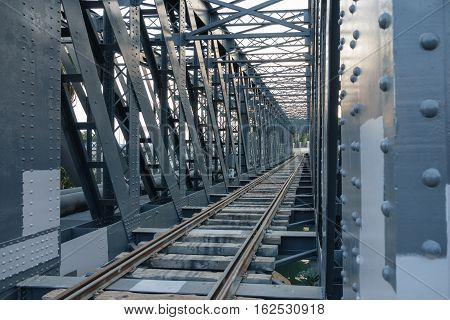 Wide angle view of iron bridge and train line