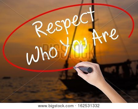 Woman Hand Writing Respect Who You Are With A Marker Over Transparent Board.