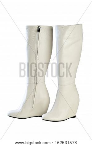 Women's boots on a white background. Women's boots white color heel platform