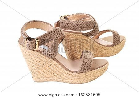 Pair of Women's Neutral colored Sandals Isolated on White