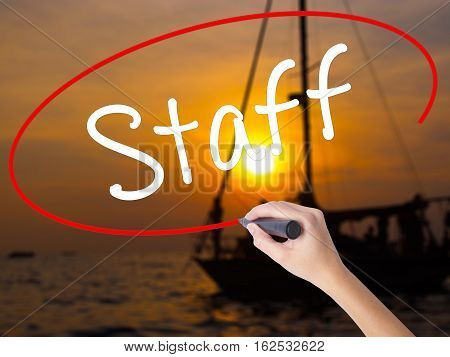 Woman Hand Writing  Staff With A Marker Over Transparent Board