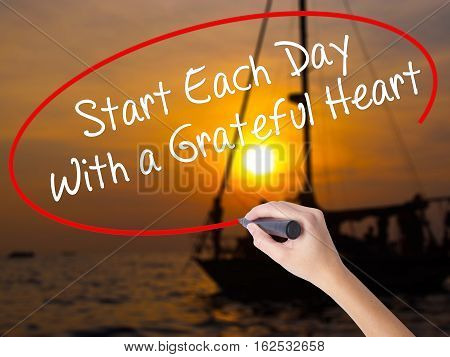 Woman Hand Writing Start Each Day With A Grateful Heart With A Marker Over Transparent Board