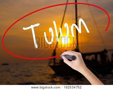 Woman Hand Writing Tulum With A Marker Over Transparent Board