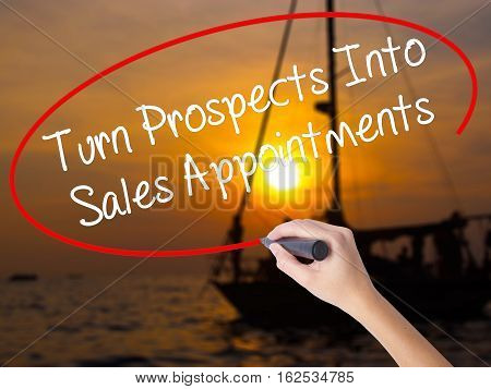 Woman Hand Writing Turn Prospects Into Sales Appointments With A Marker Over Transparent Board.