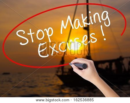 Woman Hand Writing Stop Making Excuses With A Marker Over Transparent Board
