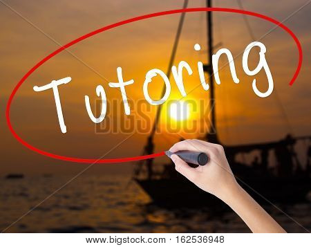 Woman Hand Writing Tutoring With A Marker Over Transparent Board