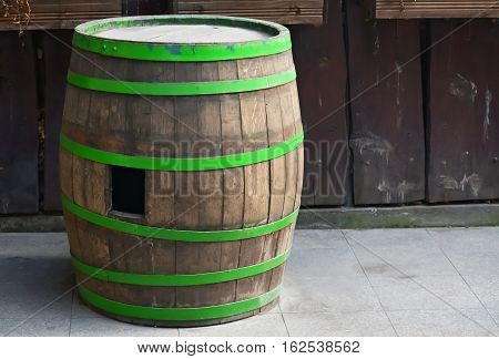 Closeup of an old wooden barrel for wine in the yard