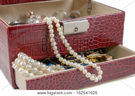 The red casket with jewelry is photographed a close-up