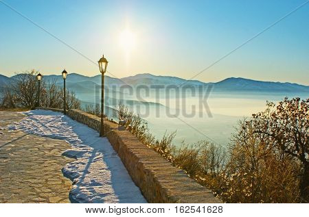 The viewpoint in mountains overlooks the misty valley of Orestiada Lake and Kastoria Greece.