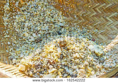 The wicker basket full of washed stones extracted from moonstone mine Meetiyagoda Sri Lanka.