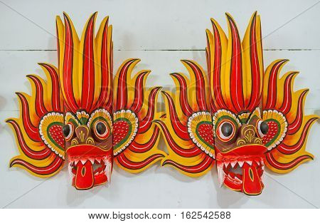 AMBALANGODA SRI LANKA - DECEMBER 5 2016: The Ginidella Raksha masks are used by Fire dancers to ward off evil they decorated in bright red and yellow colors on December 5 in Ambalangoda.