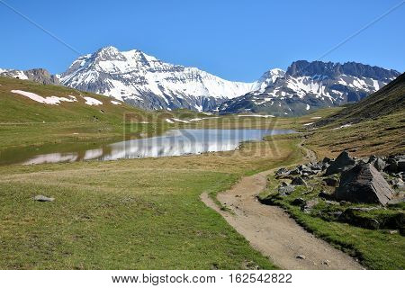 VANOISE, FRANCE: View of three summits (Grande Casse, Grande Motte and Pierre Brune) from a lake in Northern Alps