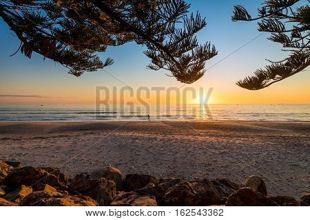 Jogging on the beach at sunset Glenelg South Australia