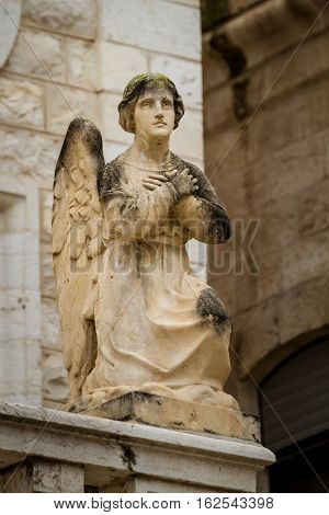 Stone sculpture of angel in the facade of the Church Of The First Miracle the Catholic Wedding Church in Cana of Galilee Israel
