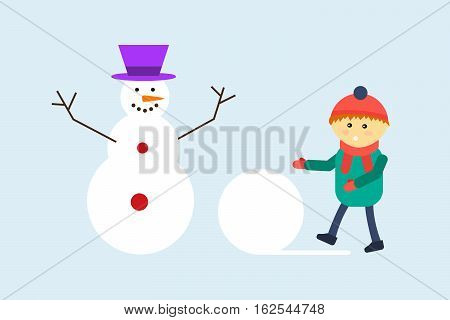 Funny little kid having fun in beautiful winter park during snowfall. Child playing winter game. Making snowman. Happiness holiday vacation time.