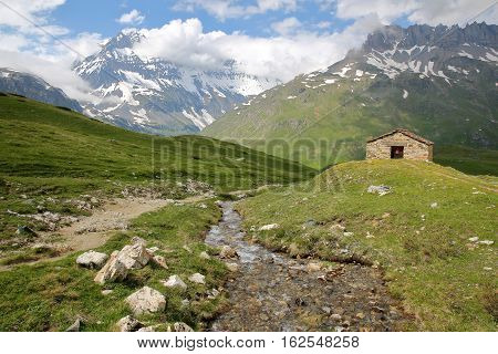 VANOISE, FRANCE:View of Grande Casse summit with St Barthelemy Chapel in the foreground, Northern Alps poster