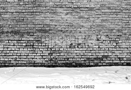 Wethered Brick Wall And Pile Of Snow.