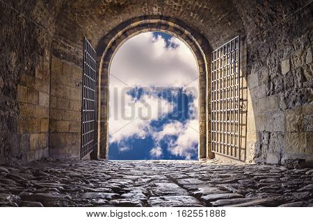 Door to Heaven. Arched passage open to heaven`s sky. Light at end of the tunnel. Hope metaphor. poster