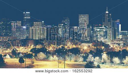 Retro Toned Denver Downtown Skyline At Night, Usa.