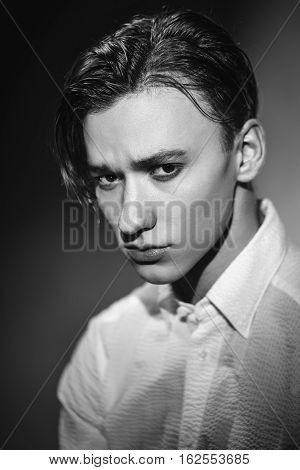 Sexy young guy with a modern men's hairstyle