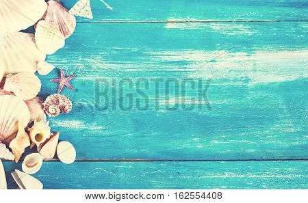 shells on the old blue wooden boards. marine still life.time to rest concept of vacation relaxation technology