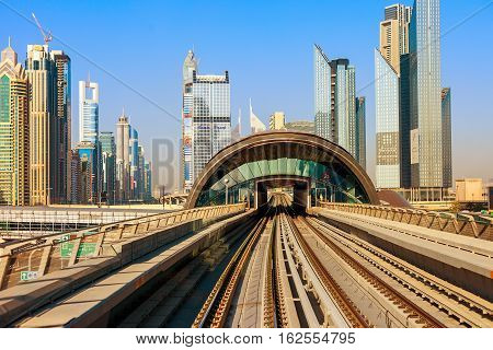 Dubai's Metro with skyscrapers  is leaving the metro station