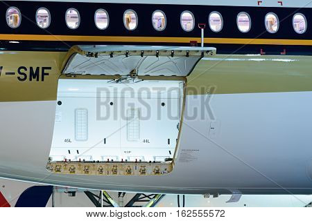 Moscow region, Domodedovo, Russia - December 15, 2016: Open the door of the luggage compartment. First visit passenger aircraft Airbus A350-900 Singapore Airlines to Domodedovo international airport.