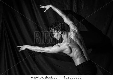 beautiful sexy muscular naked man dancing without shirt