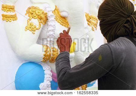 CHACHOENGSAO THAILAND - February 2 : An unidentified Muralist repair a painting on the wall of hindu god February 2 2016 in at Wat Saman Rattanaram temple ChachoengsaoThailand.