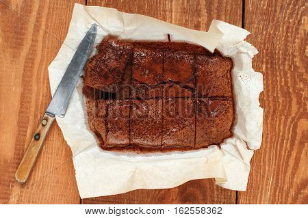 Brownie And Knife On The Wooden Table