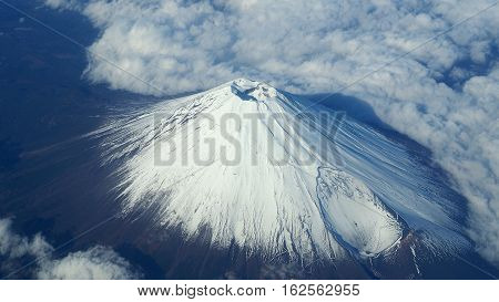 Top view of Mt. Fuji and clouds and blue sky.