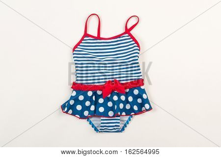 Cute children's swimsuit. Bathing suit for little girls