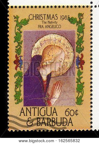 Antigua and Barbuda - CIRCA 1985: A stamp printed in Antigua and Barbuda shows Nativity by Fra Angelico, circa 1985